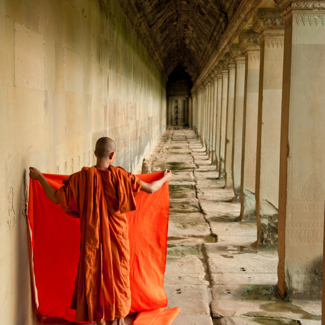 """Buddhist Monk folding robes, Angkor Wat, Cambodia"" stock image"