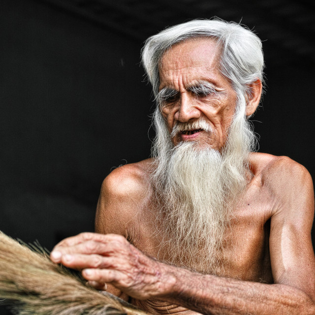 """""""The old man makes broom"""" stock image"""