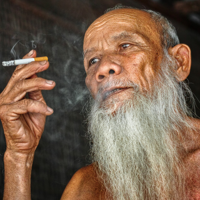 """The portrait of old man in Vietnam"" stock image"