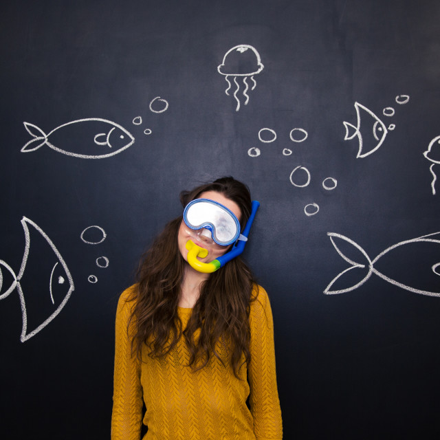 """""""Pretty woman in diving mask over chalkboard with underwater world"""" stock image"""