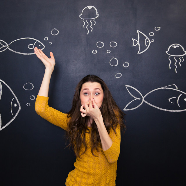 """""""Funny cute woman simulating deep diving over blackboard background"""" stock image"""