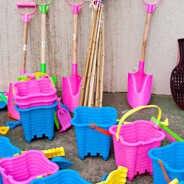 """Buckets, spades, nets and bats for sale at the beachfront"" stock image"
