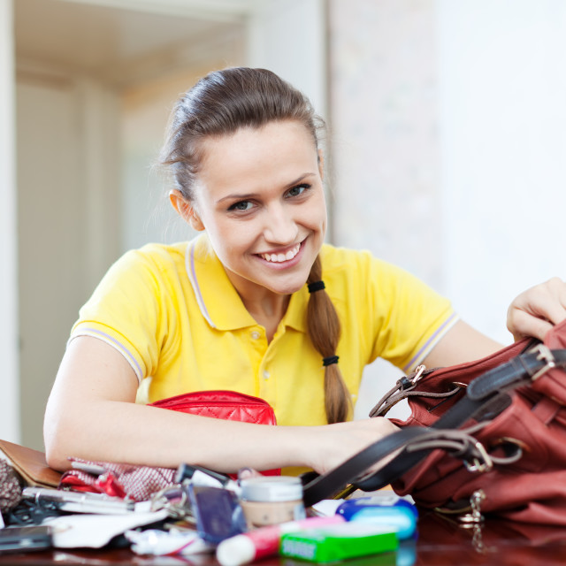 """Happy girl founded thing in handbag"" stock image"