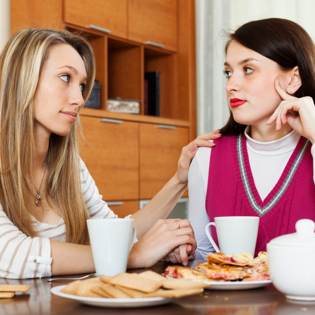 """""""brunette woman has problem, girlfriend consoling her"""" stock image"""
