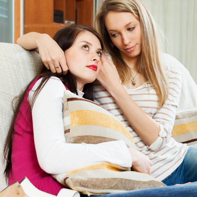 """""""woman consoling the depressed girl"""" stock image"""