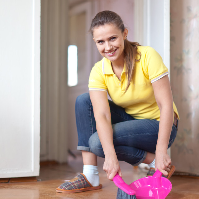 """""""Woman sweeping the floor"""" stock image"""