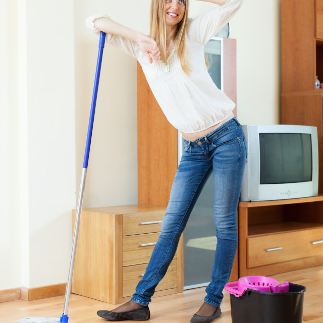 """""""fatigue long-haired woman washing floor with mop"""" stock image"""