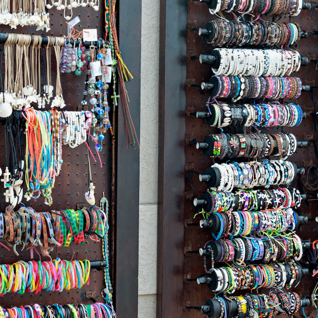 """Handmade African beadwork, bamgles and necklaces for sale at the beachfront"" stock image"