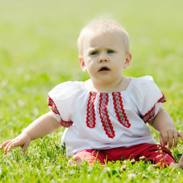 """""""baby in folk clothes"""" stock image"""