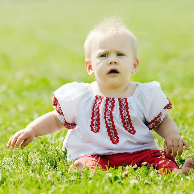 """""""baby in traditional folk clothes"""" stock image"""