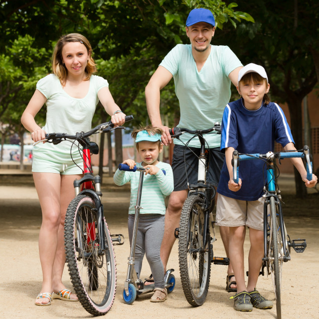"""""""Parents and kids with bicycles"""" stock image"""