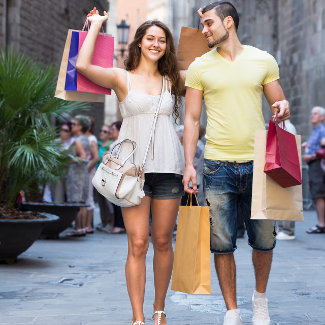"""travelers walking after shopping"" stock image"