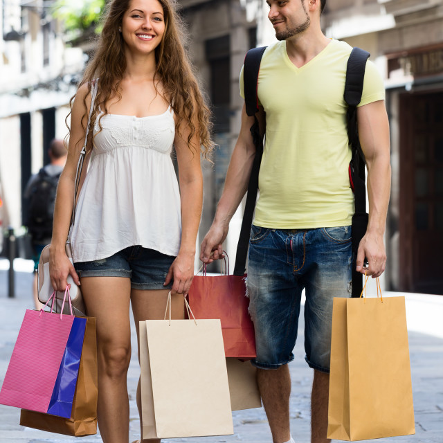"""""""happy young loving pair with shopping bags at city"""" stock image"""