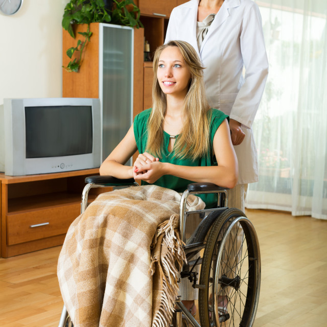 """Physician and disabled girl communicating"" stock image"