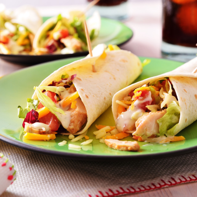 """Two Chicken fajitas on green plate"" stock image"