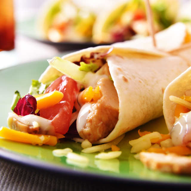 """Two Chicken fajitas on green plate close up"" stock image"