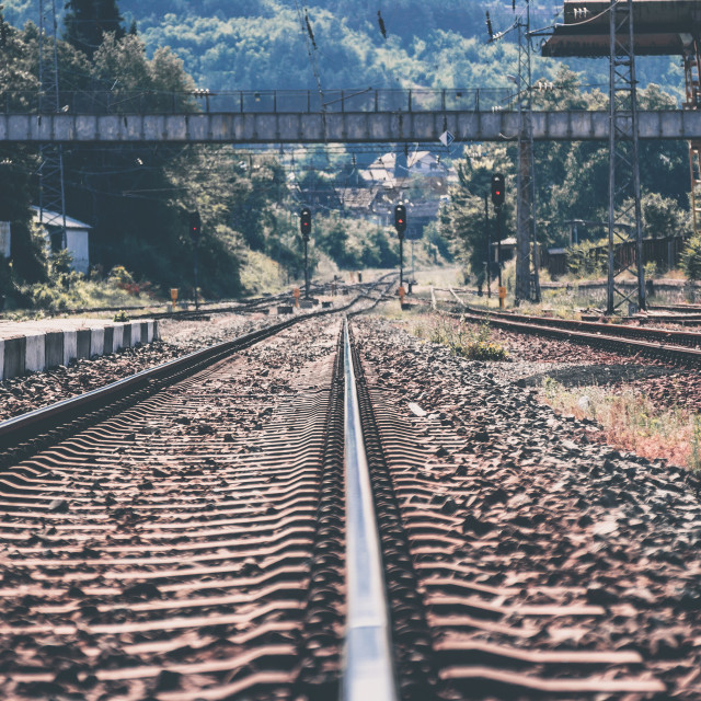 """Railway on small city train station"" stock image"