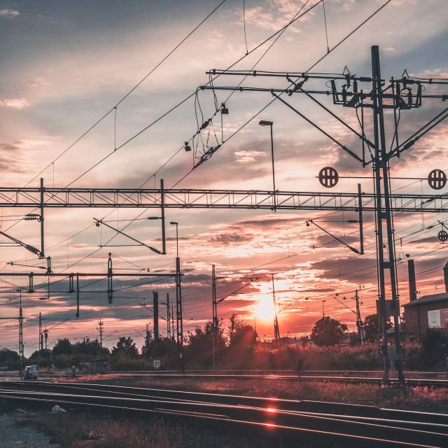 """Dramatic sunset over train yard"" stock image"
