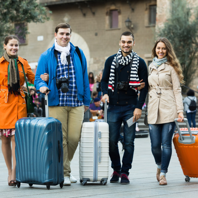 """""""travelers with baggage sightseeing and smiling in autumn"""" stock image"""