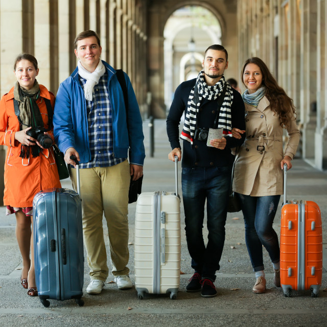 """""""Tourists with luggage walking by street."""" stock image"""