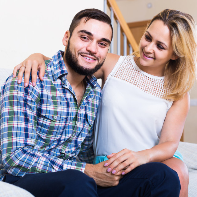 """""""guy and cheerful pretty girl smiling indoors"""" stock image"""