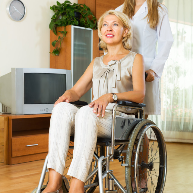 """Physician and disabled woman communicating"" stock image"