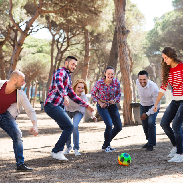 """""""Friends playing football"""" stock image"""
