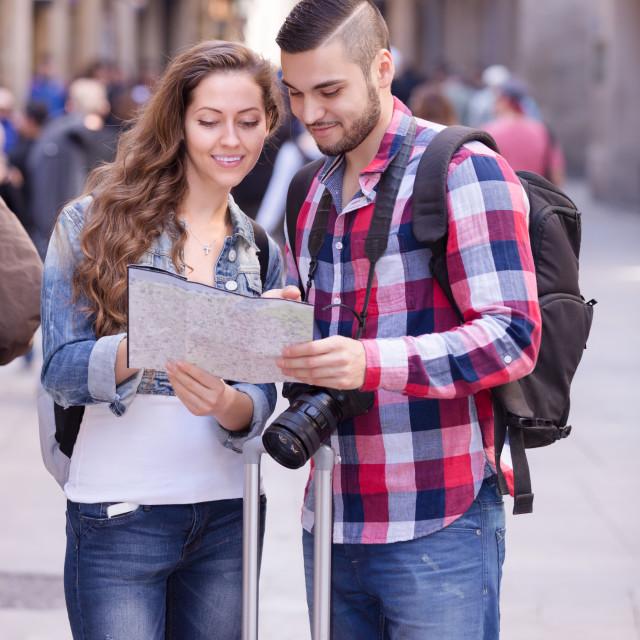 """Couple with luggage walking"" stock image"
