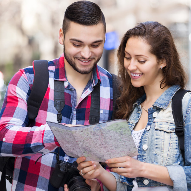 """""""Couple with trunk and backpack"""" stock image"""