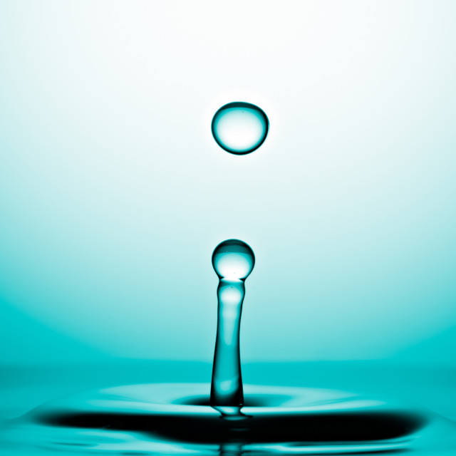 """Water Drop Macro, Cyan Background"" stock image"