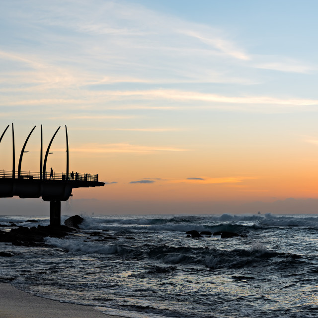 """View of the Indian Ocean through the Millennium Pier in Umhlanga Rocks at Sunrise"" stock image"