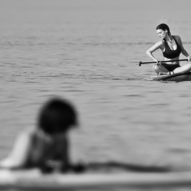 """A woman on a paddleboard"" stock image"