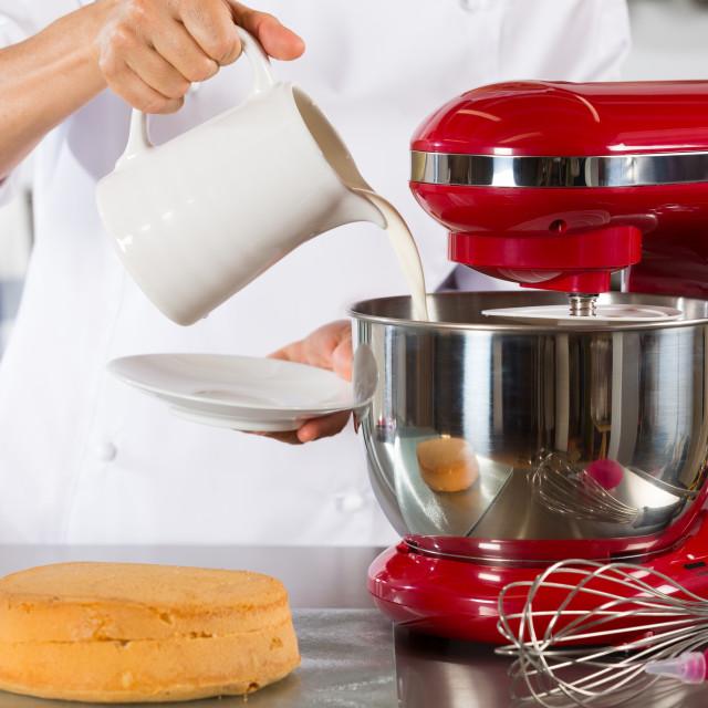 """""""Chef preparing cream"""" stock image"""