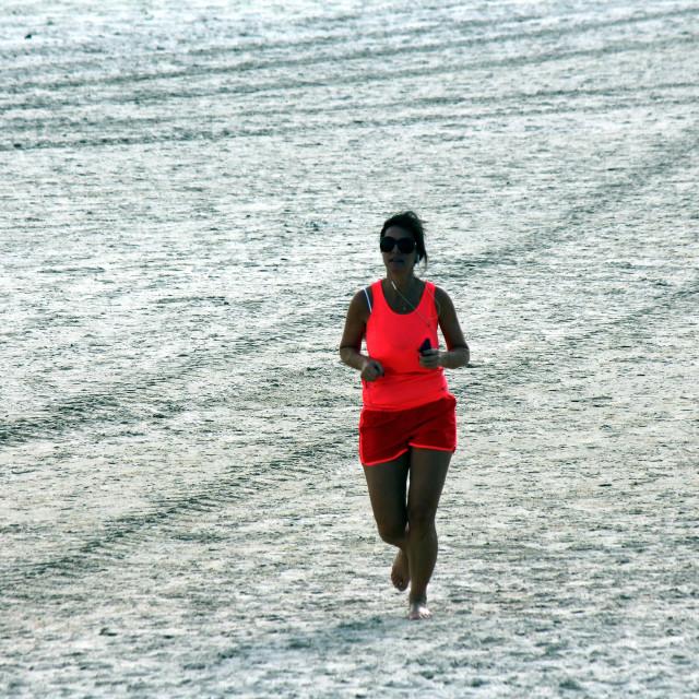"""Running on the beach"" stock image"