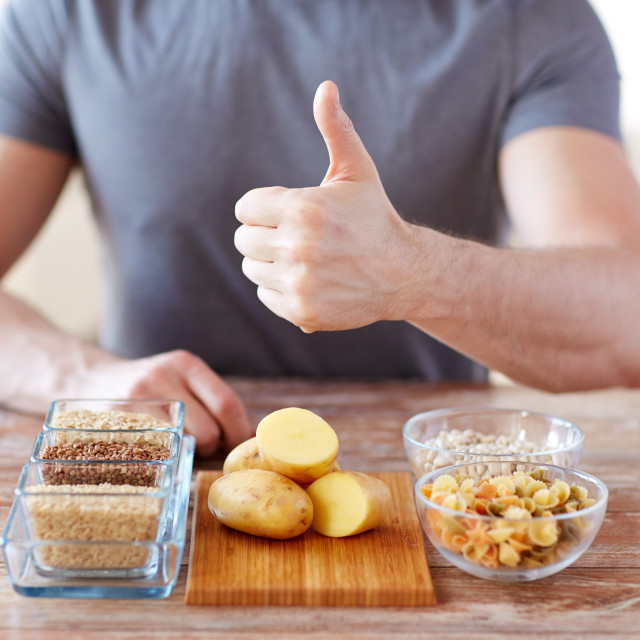 """close up of male hands with carbohydrate food"" stock image"