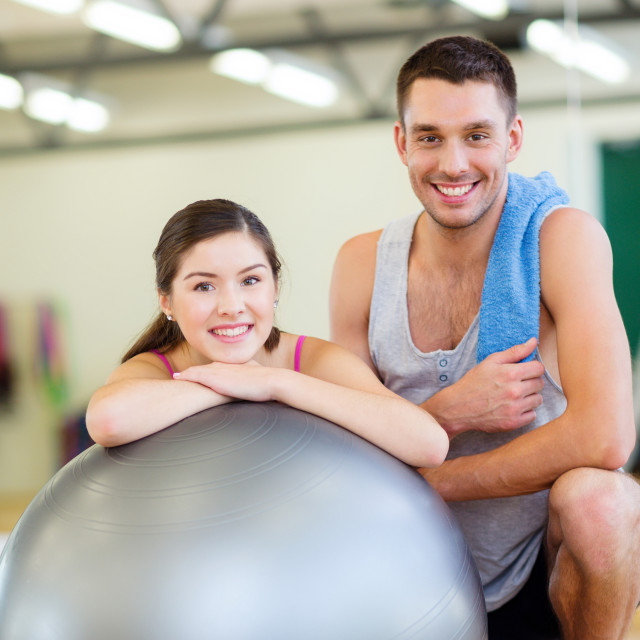 """two smiling people with fitness ball"" stock image"