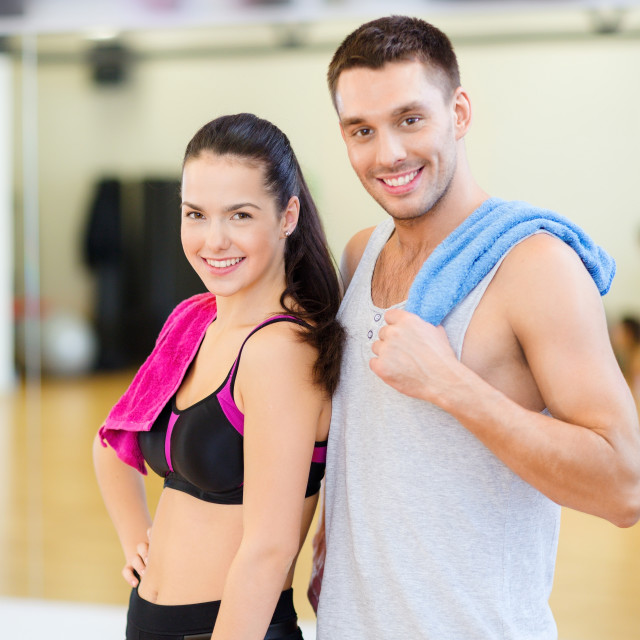 """two smiling people in the gym"" stock image"