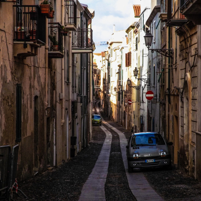 """Street in old town Alghero"" stock image"