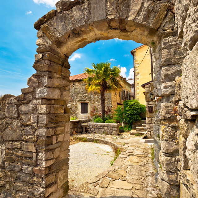 """Town of Hum stone gate and street"" stock image"