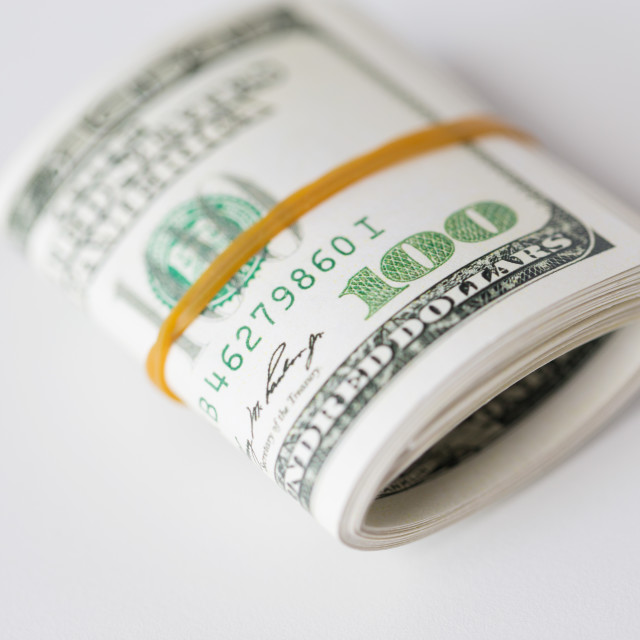 """""""close up of dollar money packet tied with rubber"""" stock image"""