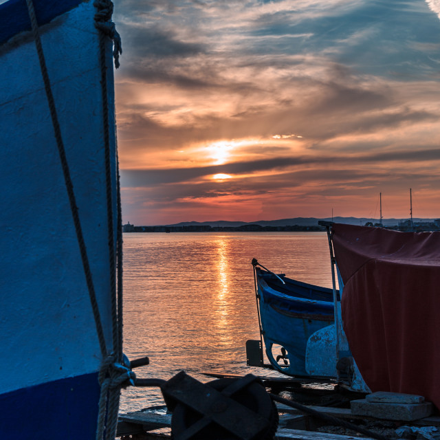 """""""Sea side sunset over fishing boats"""" stock image"""