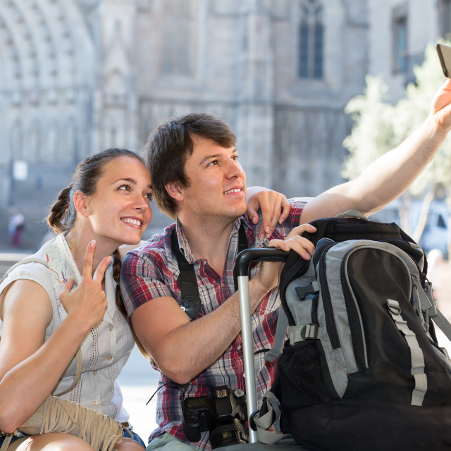 """""""Couple with luggage doing selfie"""" stock image"""