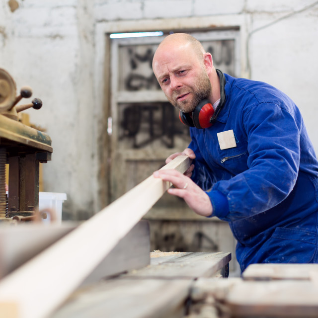 """""""Worker at wood processing manufactory"""" stock image"""