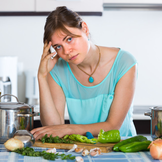 """""""Portrait of tired woman at kitchen."""" stock image"""