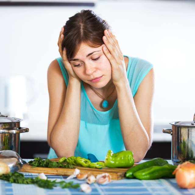"""""""Sad housewife cooking dinner"""" stock image"""