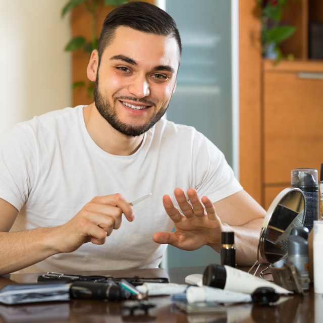 """""""Man doing manicure at home"""" stock image"""
