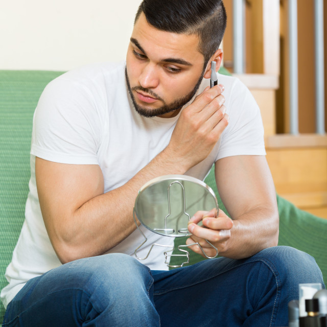 """""""Young man using hair trimmer."""" stock image"""