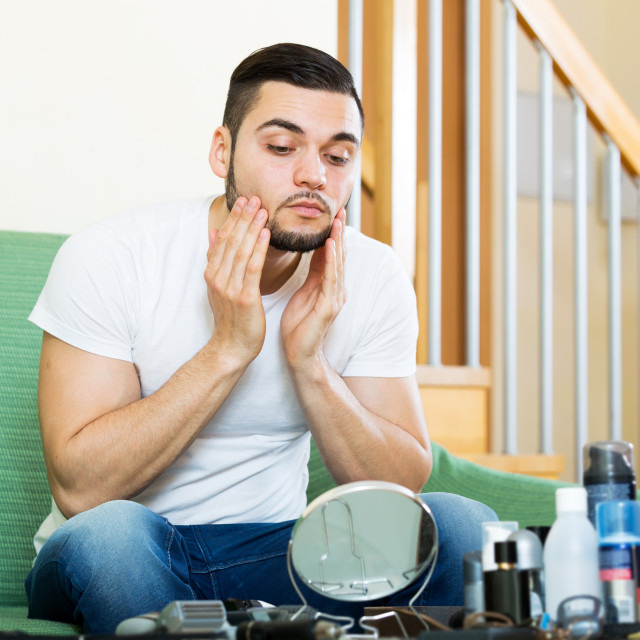"""""""man discovering his first wrinkles"""" stock image"""