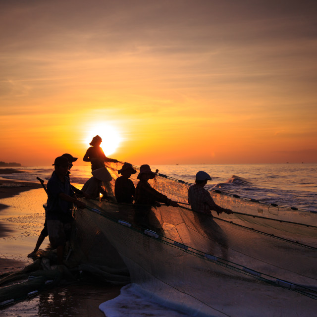 """the Fishermen fishing nets when sunrise"" stock image"