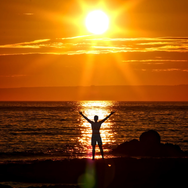 """Embracing the sunset"" stock image"